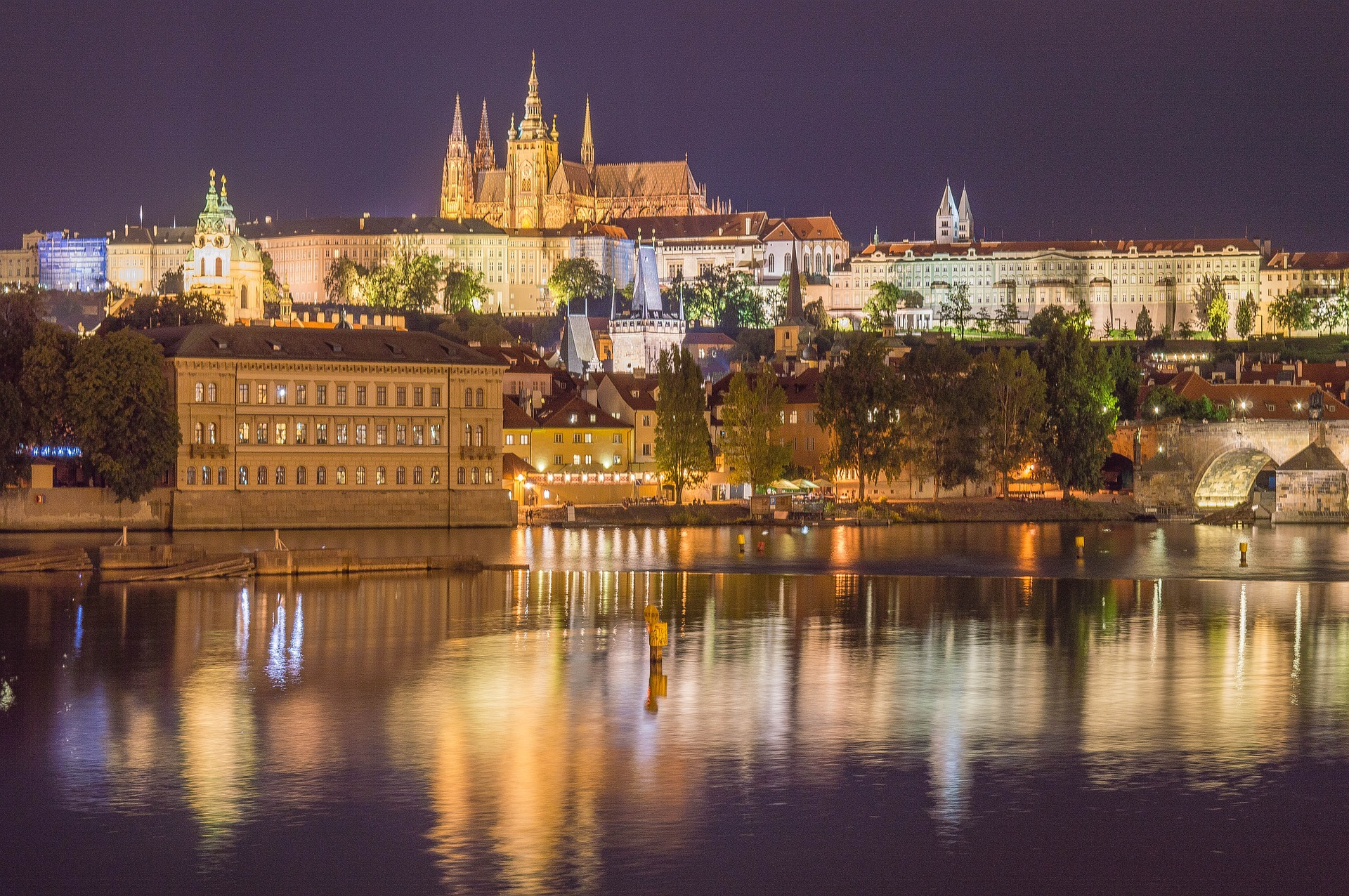 View of Prague Castle at night from the river