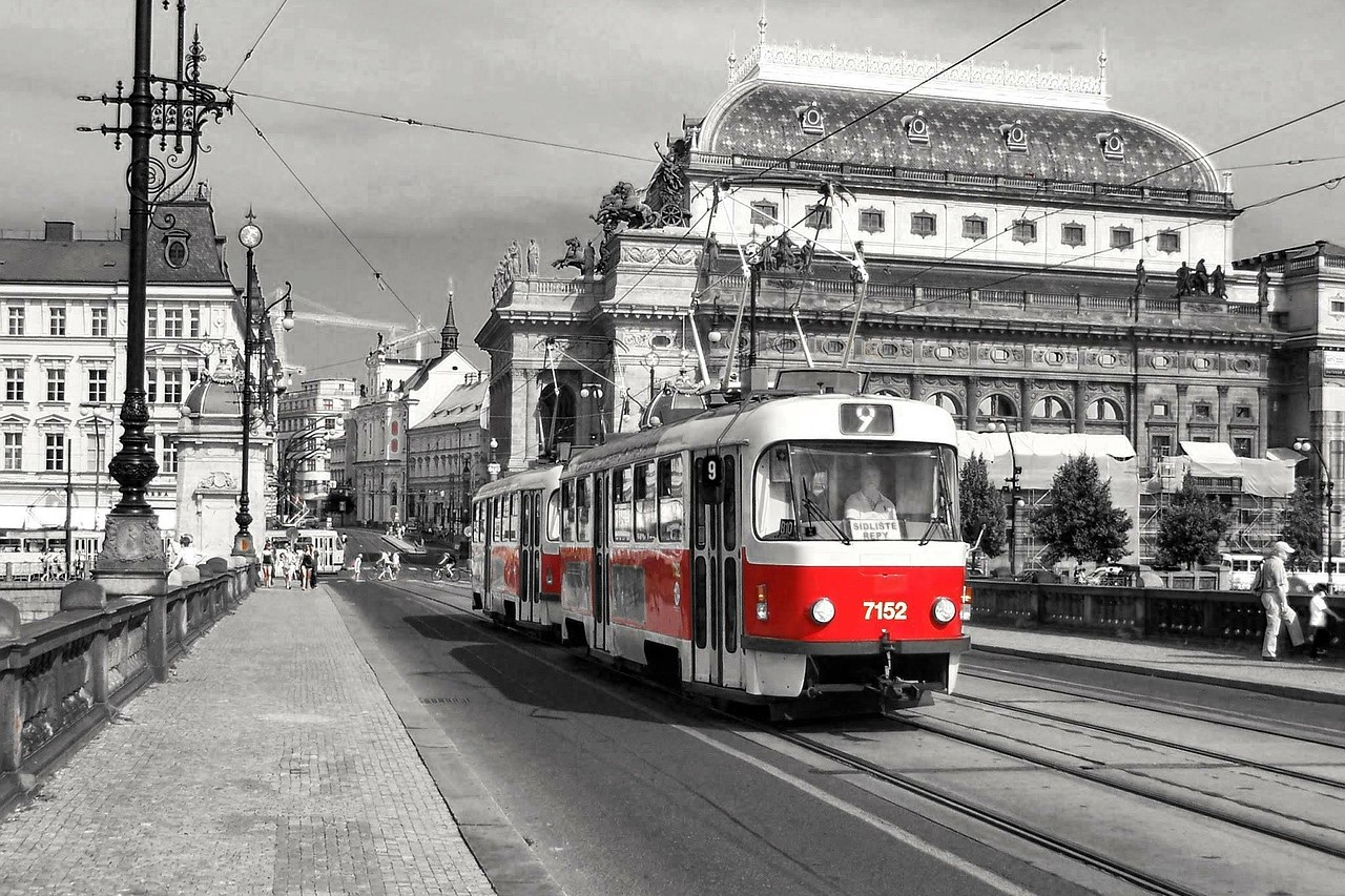Historical Prague Tram passing by the Czech National Theater