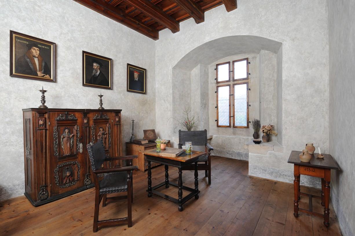 Interior furniture and artwork typical of the time Karlštejn Castle was built.